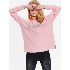 Bluzy damskie: DAMSKA BLUZA Z MIŁEJ W DOTYKU DZIANINY Z BŁYSZCZĄCĄ APLIKACJĄ