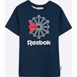 Reebok - T-shirt dziecięcy 104-172 cm. Niebieskie t-shirty chłopięce z nadrukiem Reebok, z bawełny, z okrągłym kołnierzem. Za 69,90 zł.