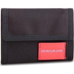 Duży Portfel Męski CALVIN KLEIN JEANS - Sp Essential + Canvas Billfold K40K400841 001. Czarne portfele męskie marki Calvin Klein Jeans, z jeansu. Za 179,00 zł.