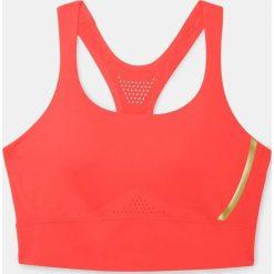 Biustonosze sportowe: Under Armour Biustonosz Breatehlux Perforated Mid czerwony r. L (1307229-985)
