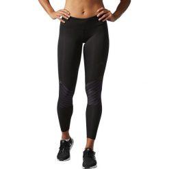 Adidas Spodnie damskie Supernova TKO Long Tight czarne r. XS (B28253). Czarne spodnie sportowe damskie marki Adidas, xs. Za 219,42 zł.